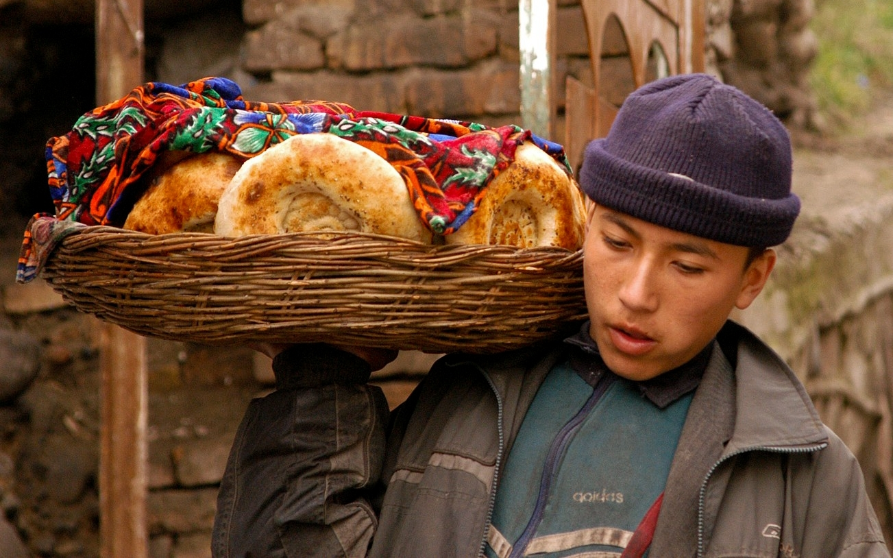young man with a basket filled with pastries